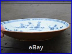 A Chinese Blue & White Dish with batavia brown underside cafe au lai Qianlong