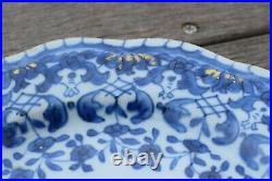 A antique chinese blue and white dish with molded rim period of Qianlong