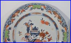 A pair of 18th century Chinese blue and white clobbered octagonal plates