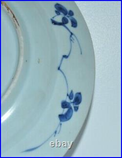 An elegant Chinese circa 1700 Kangxi period blue and white plate signed bottom